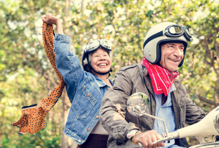 Retired couple having fun on a motorcycle