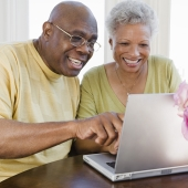 Older couple looking into investments