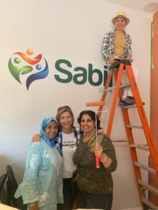 Claudia volunteering for Sabil USA
