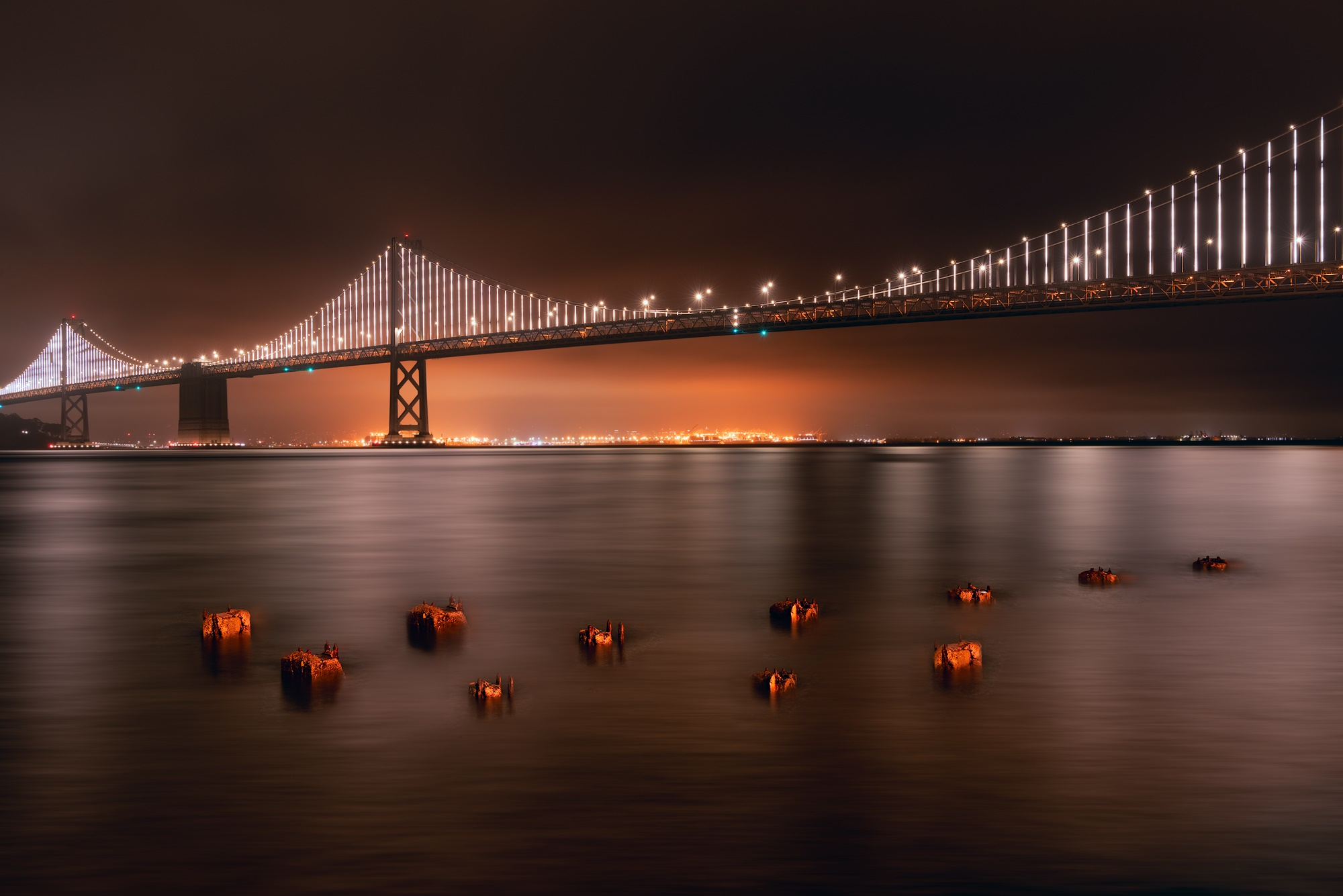 Photo of the Bay Bridge on a foggy night in San Francisco captured by Greg Smith