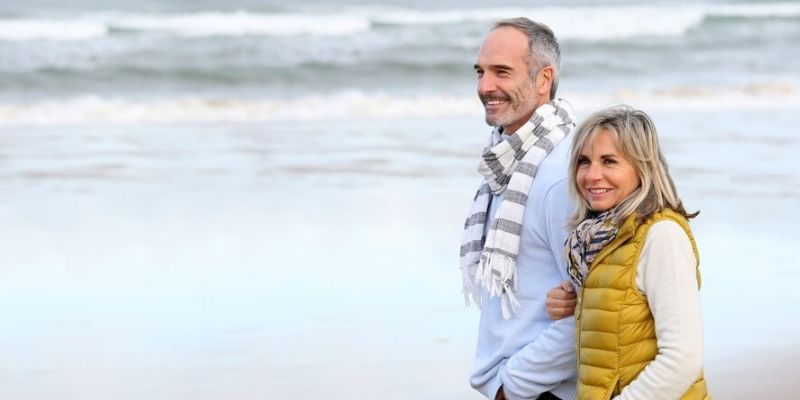 Retired couple walking the beach in Santa Barbara