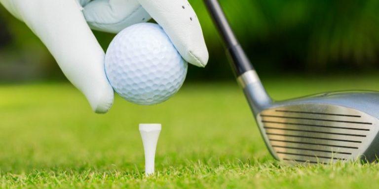 teeing up a golf ball