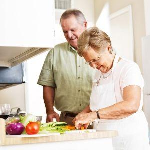 Couple make food together