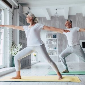 Yoga and stretching at home - 4 Self-Care Tips for Coping with Coronavirus Quarantine - Mission Wealth