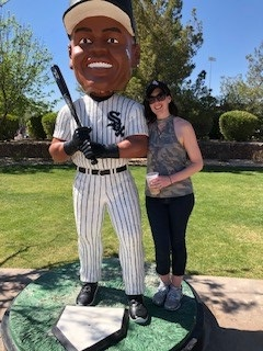 Jorie standing next to a statue of a Chicago White Sox baseball figure.